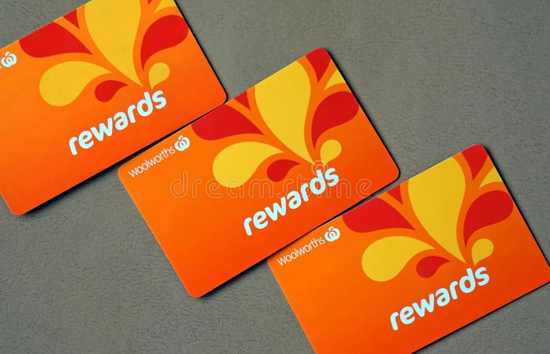 Close-up of Woolworths Rewards loyalty cards. Woolworths Supermarkets is an Australian grocery store chain royalty free stock image
