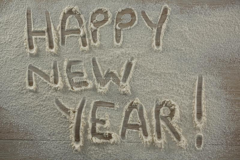 The word happy new year written on sprinkled flour. Close-up of the word happy new year written on sprinkled flour royalty free stock photos