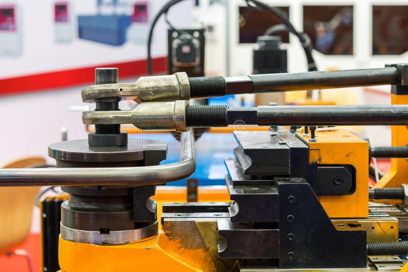 Close up work piece and jig of high technology and precision cnc automatic pipe or tube bending machine for industrial.  stock images