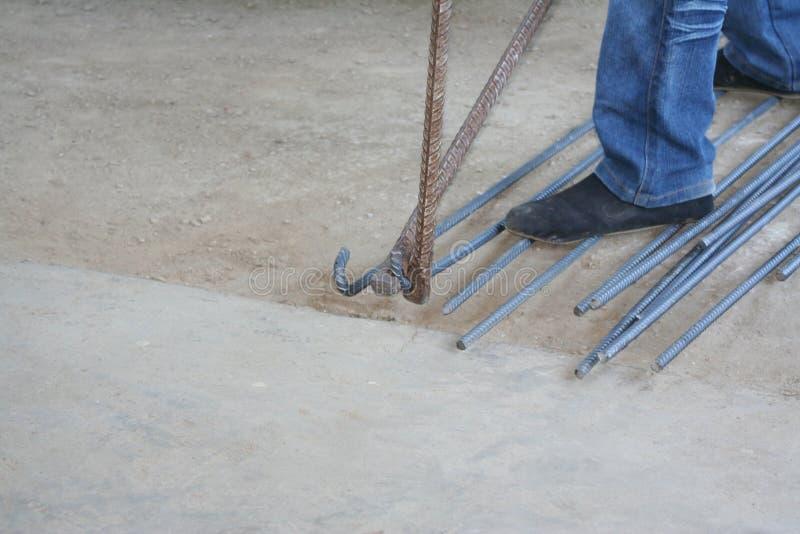 Worker bending steel with steel bending equipment by hand. Close up Worker bending steel with steel bending equipment by hand royalty free stock photography