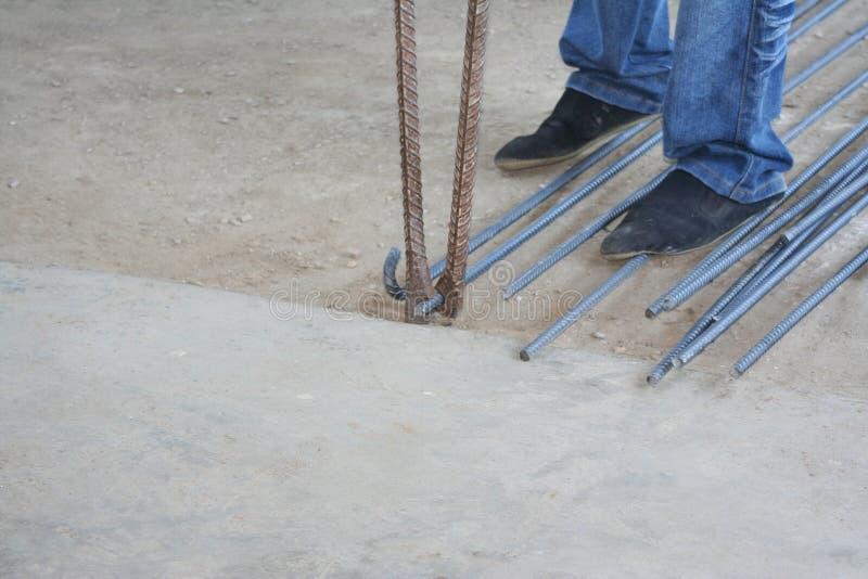 Worker bending steel with steel bending equipment by hand. Close up Worker bending steel with steel bending equipment by hand stock photos