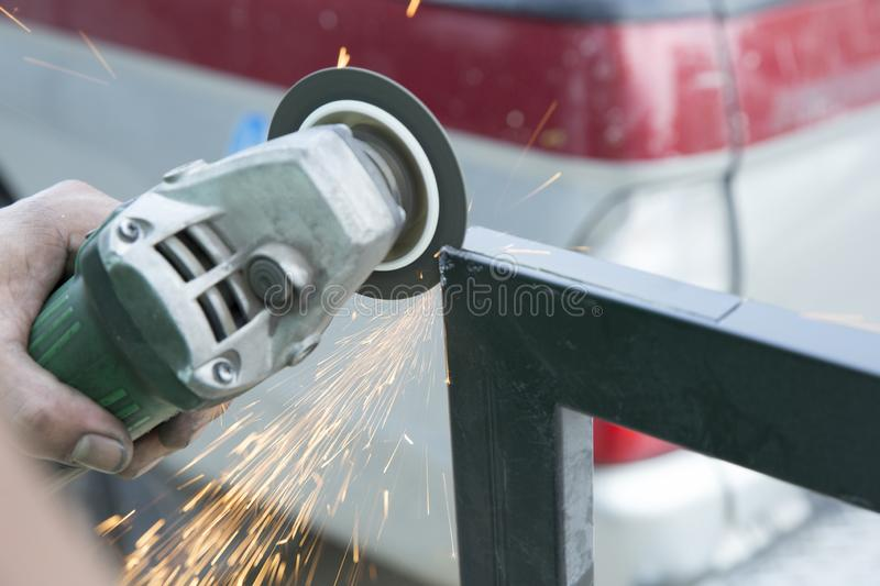 Industrial worker with grindstone abrasive disc cutter machine stock image