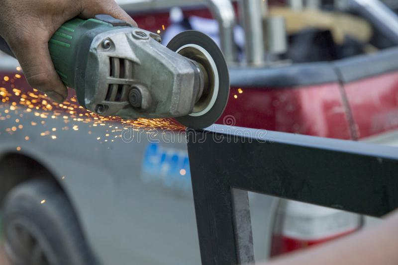 Industrial worker with grindstone abrasive disc cutter machine stock photo