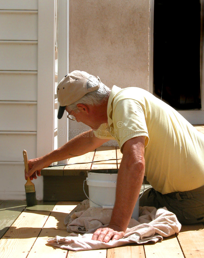 Free Close Up Worker Staining Deck Stock Image - 223931