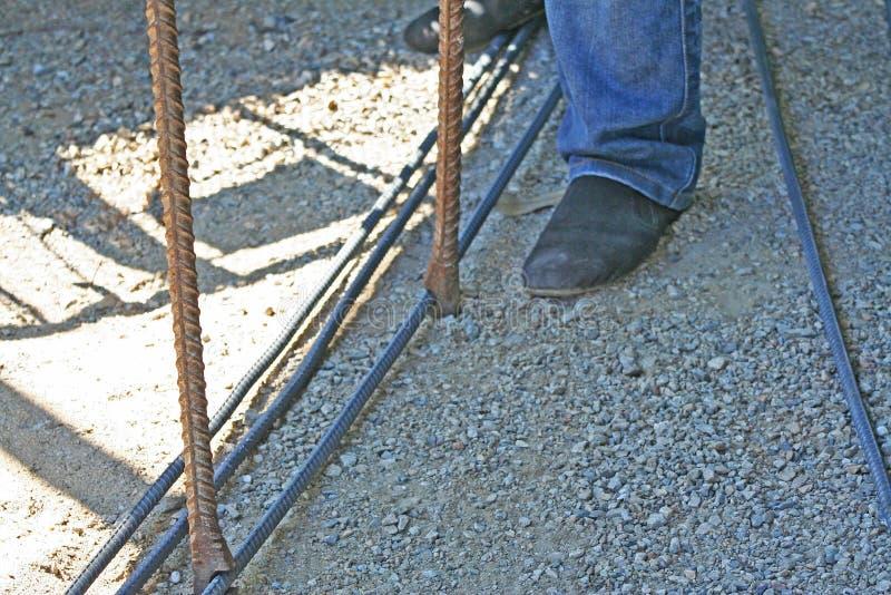 Workers are bending steel with steel bending equipment. Close up Workers are bending steel with steel bending equipment stock images