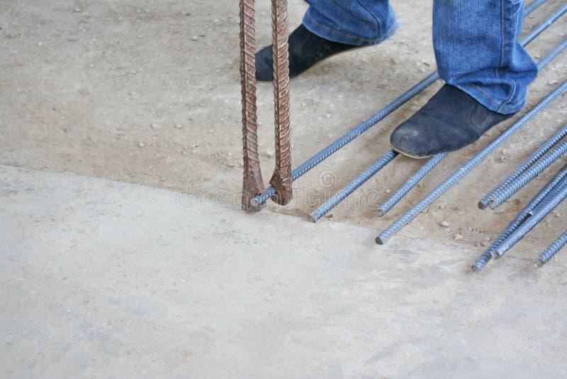 Workers are bending steel with steel bending equipment. Close up Workers are bending steel with steel bending equipment royalty free stock images