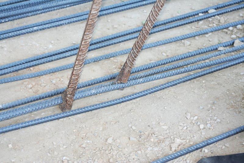 Workers are bending steel with steel bending equipment. Close up Workers are bending steel with steel bending equipment royalty free stock photos
