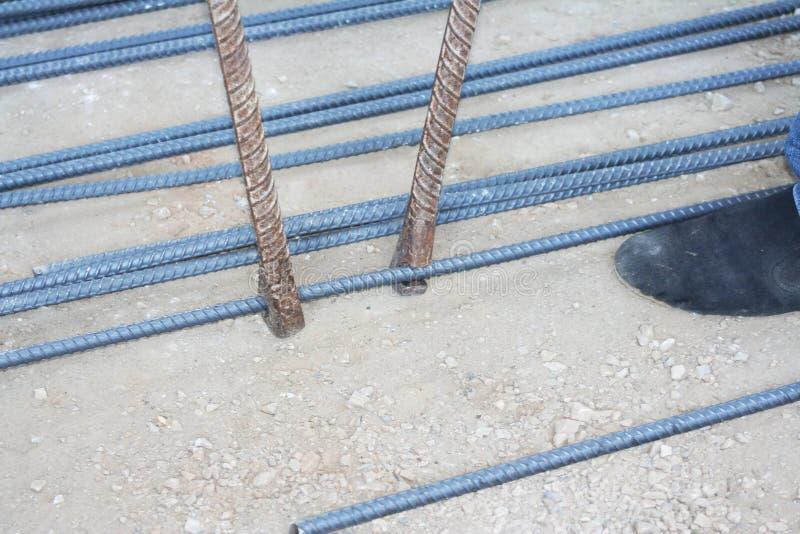 Workers are bending steel with steel bending equipment. Close up Workers are bending steel with steel bending equipment royalty free stock photo