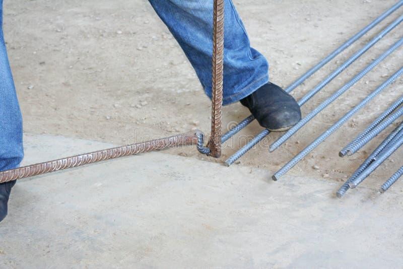 Workers are bending steel with steel bending equipment. Close up Workers are bending steel with steel bending equipment stock photos