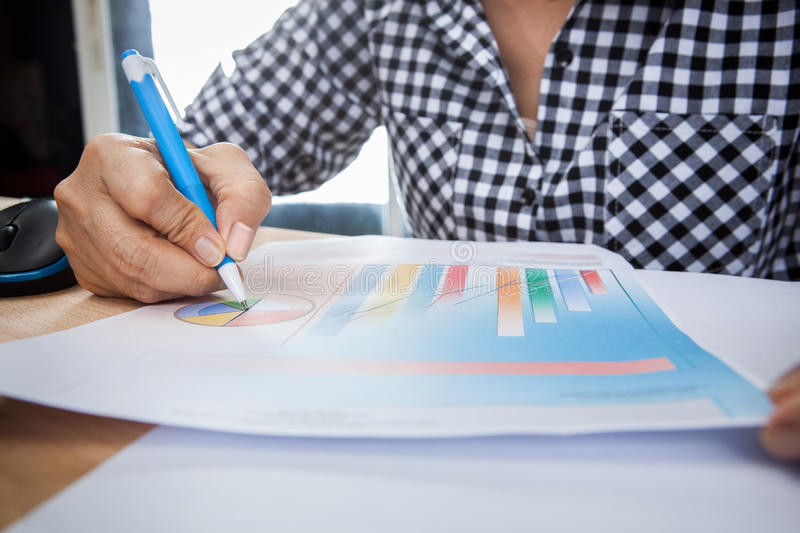 Close up working woman hand writing pen on business report chat royalty free stock photo