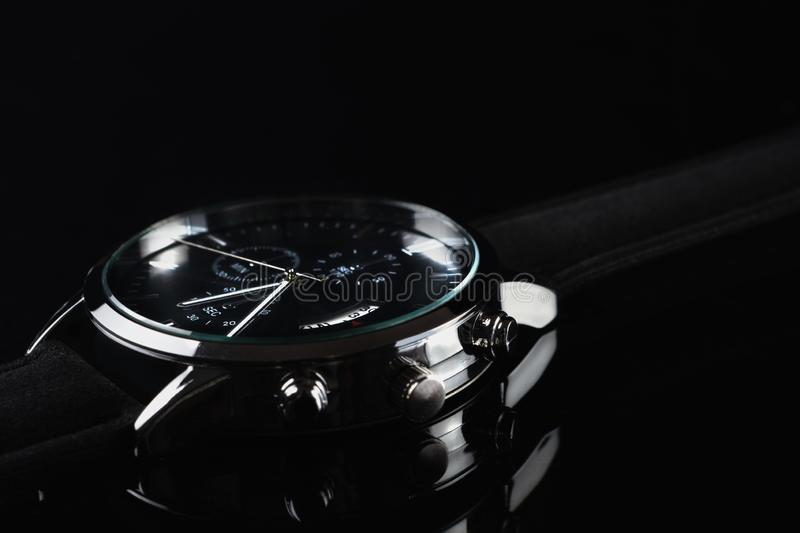 Close up of wrist watch for men on dark background stock photos