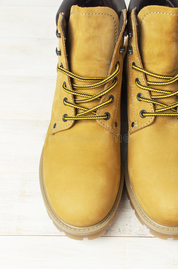 Free Close-up Yellow Men`s Work Boots From Natural Nubuck Leather On Wooden White Background. Trendy Casual Shoes, Youth Style. Concep Royalty Free Stock Photo - 136726455