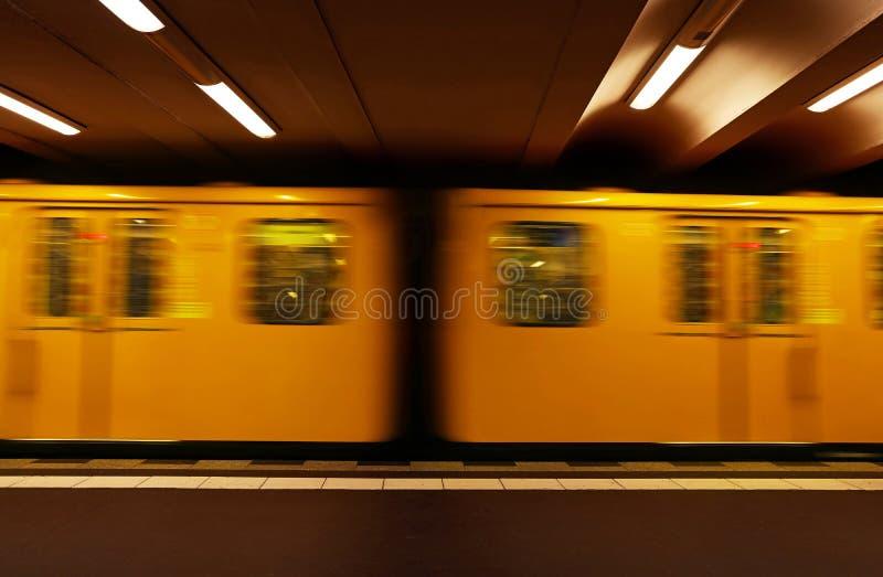 Yellow metro underground carriage of U-Bahn train in motion, sid. Close up yellow metro underground train carriage in motion, side view royalty free stock images