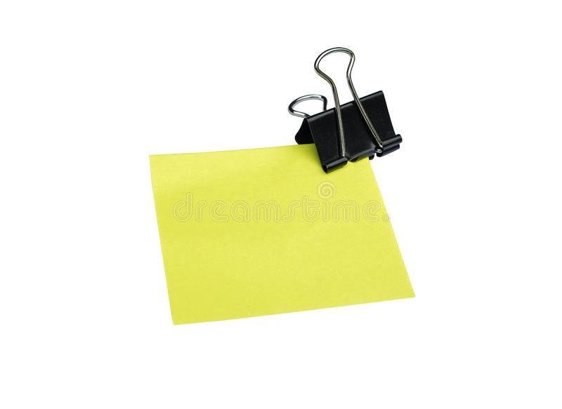 Close-up Yellow note and black clip isolated on white background stock photos