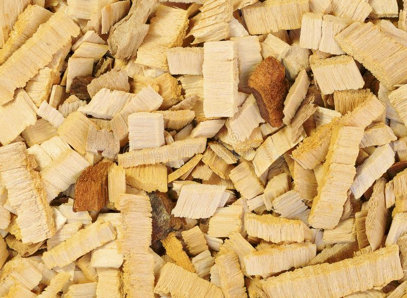 Close up wood chips of alder-tree for smoking or recycle. Texture for background. Close up yellow and red wood chips of alder-tree for smoking or recycle stock photography