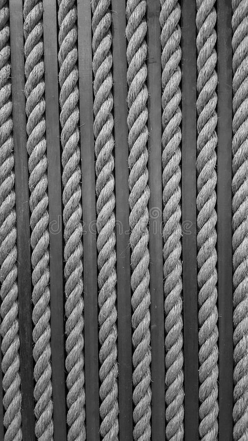 Close up yellow rough rope for texture Backgroud. A rope is a group of yarns, plies, or strands that are twisted or braided together into a larger and stronger stock image