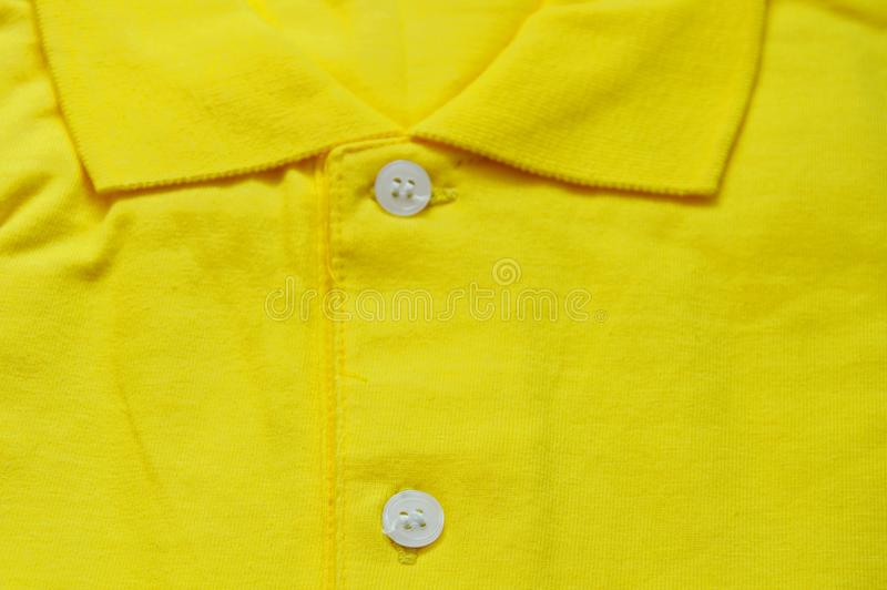 Yellow sports shirt fold texture and background. Close up of yellow sports shirt fold texture and background royalty free stock photography