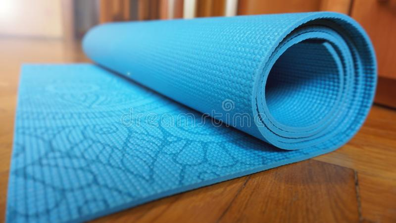Close Up Of Yoga, Fitness Floor Mat At Home In A Roll