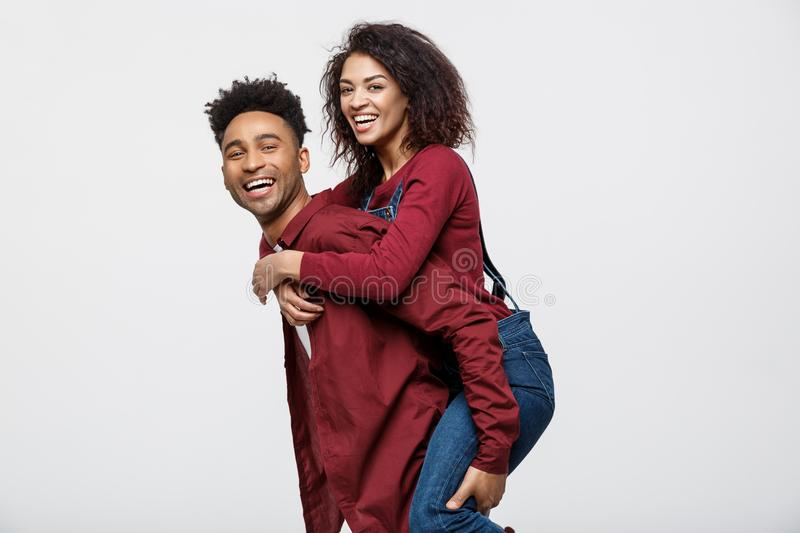 Close-up young african american couple enjoy riding back. stock photo
