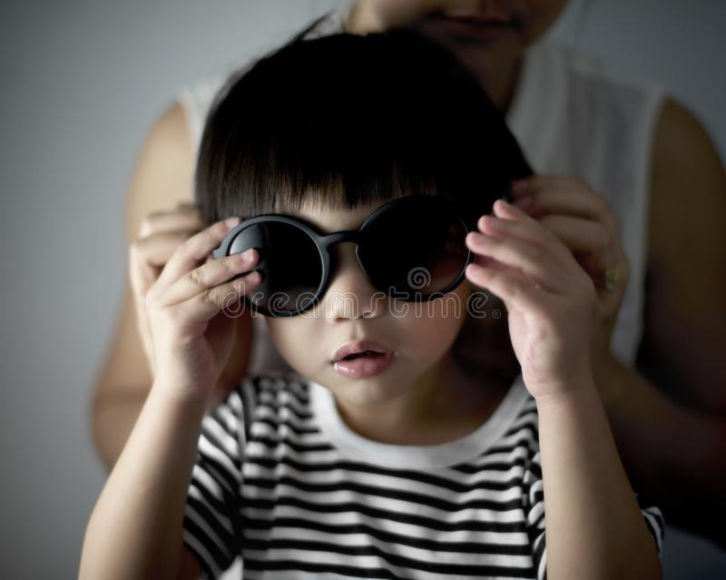 Close up of a young child wearing sunglasses stock photos