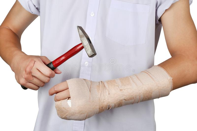 Student broken bone finger and arm by themselves with hammer. royalty free stock photo
