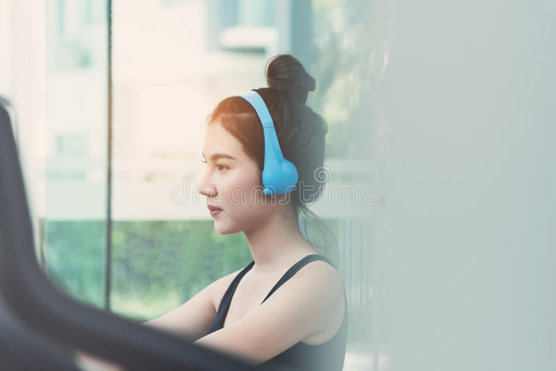 Close up Young Asian girl with blue headphone stock photos