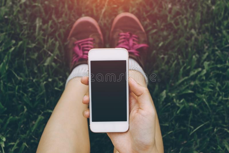 Close up of young asian healthy women`s hands holding cell telephone. royalty free stock photos