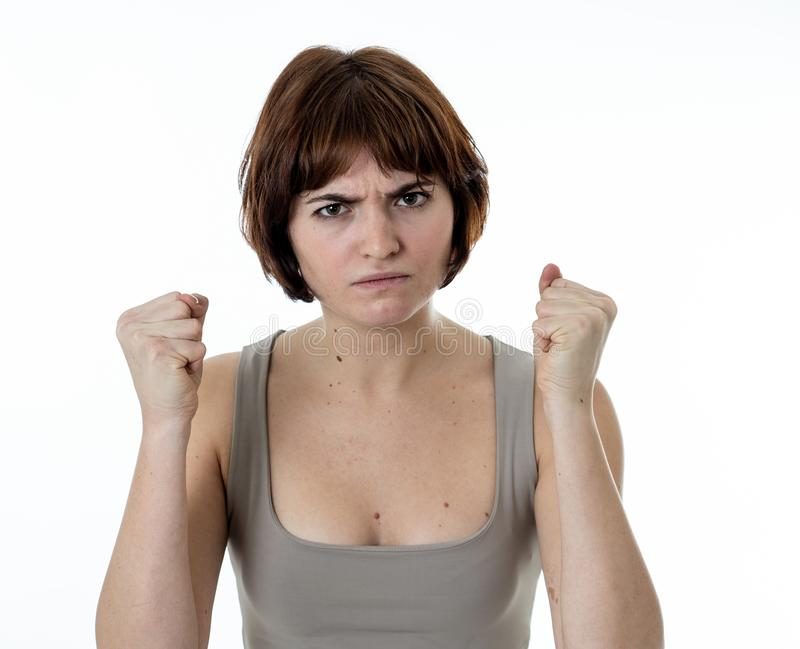 Portrait of a beautiful young woman with angry face looking furious. Human expressions and emotions. Close up of young attractive frustrated caucasian woman with royalty free stock photo