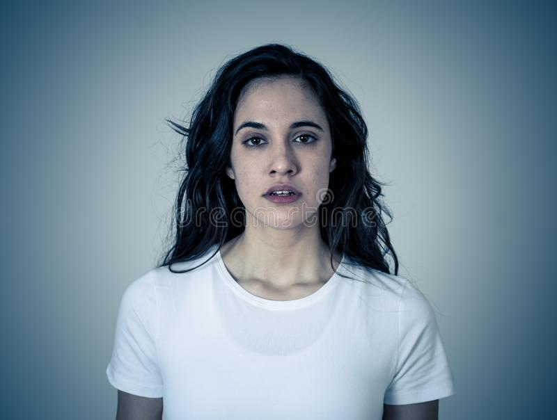 Portrait of beautiful young latin woman with angry and furious face. Human expressions and emotions. Close up of young attractive frustrated latin woman in stock image