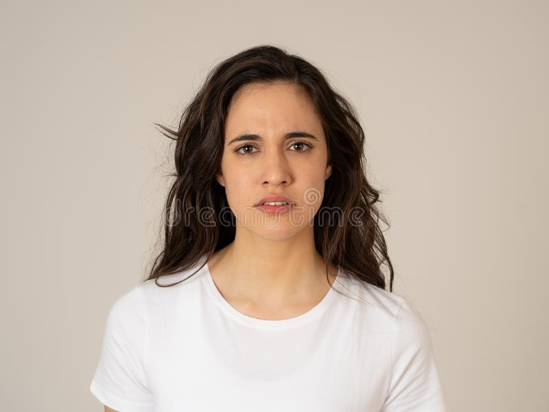 Portrait of beautiful young latin woman with angry and furious face. Human expressions and emotions. Close up of young attractive frustrated latin woman in stock photos
