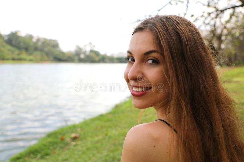 Close up of young beautiful woman relaxing and sitting on grass in Ibirapuera Park, Sao Paulo, Brazil stock photography
