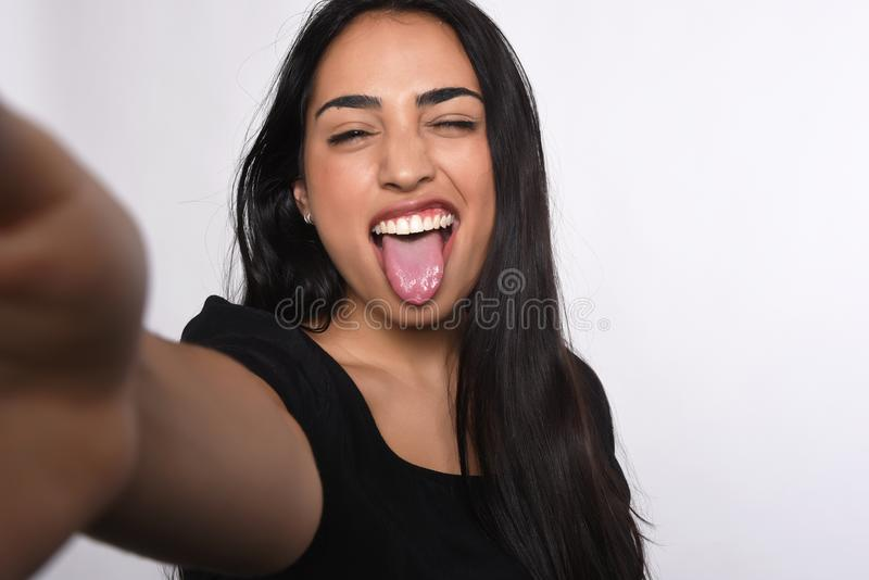 Young woman taking selfie. Close-up of young beautiful woman taking selfie. white background stock photos