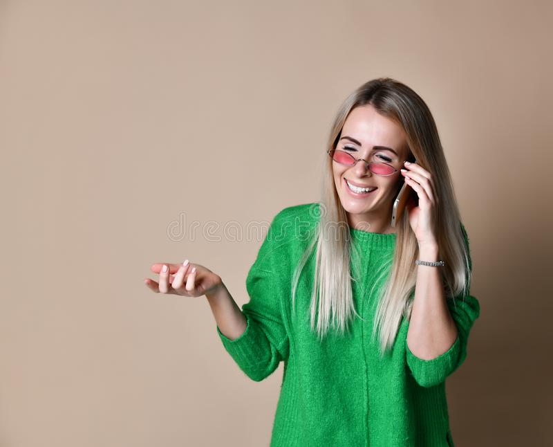 Close up Young blonde Woman Talking to Someone on her Mobile Phone While Looking Into the Distance with Happy Facial Expression royalty free stock photos