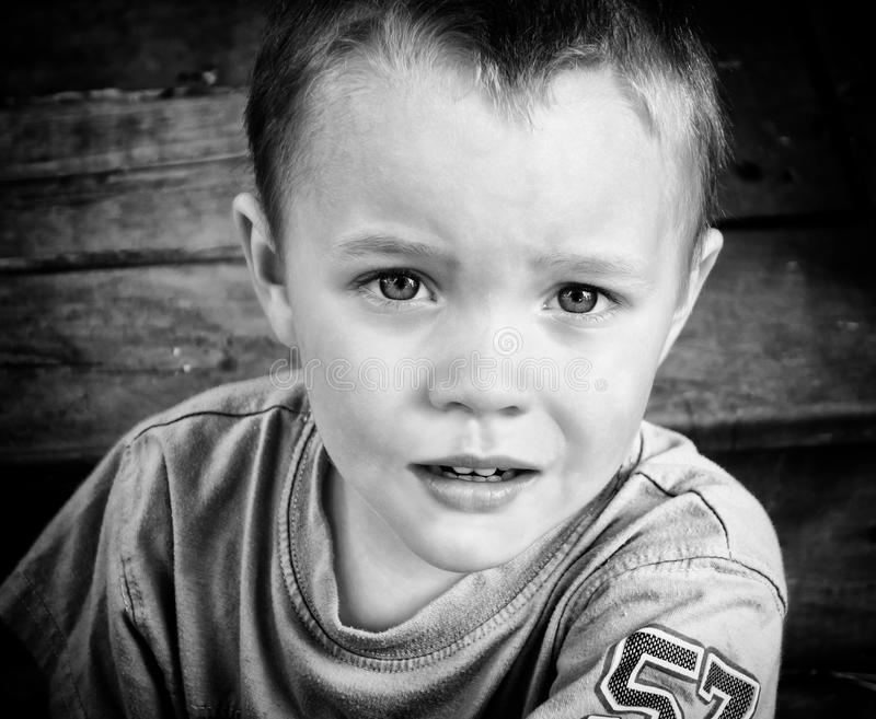 Close Up of A Young Boys Face - Black and White royalty free stock image