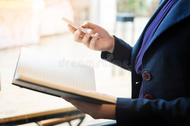 Close up of young business man using mobile smart phone for work stock photography