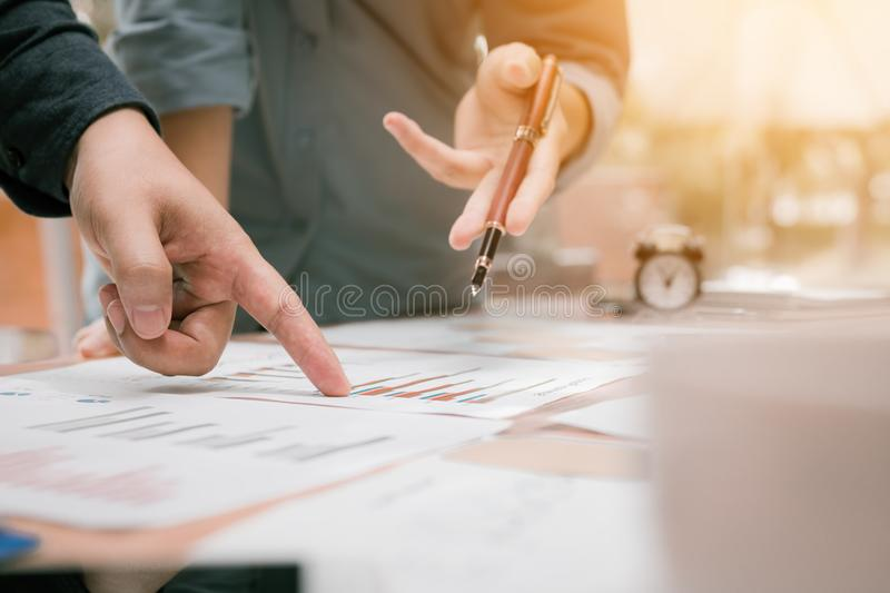 Close up of young business people group analysis to data paper c royalty free stock photo