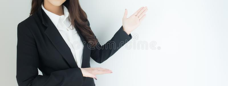 Close up of young business woman pointing up over white background. Banner with copyspace for your text. royalty free stock photos