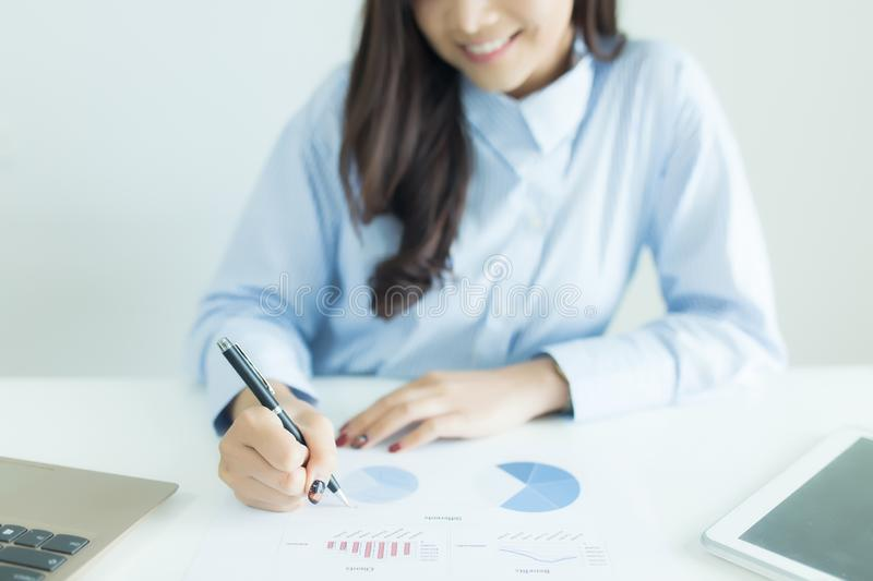 Close up of young business woman working at desk with documents. royalty free stock photo
