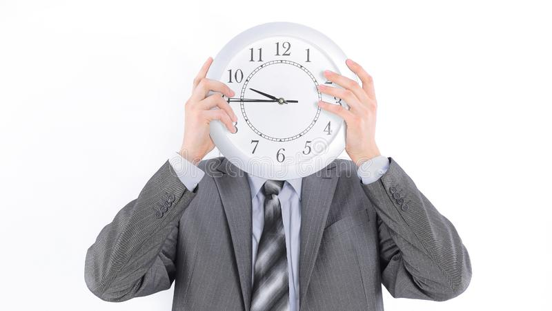 Close-up.young businessman holding a clock. isolated on white royalty free stock photo