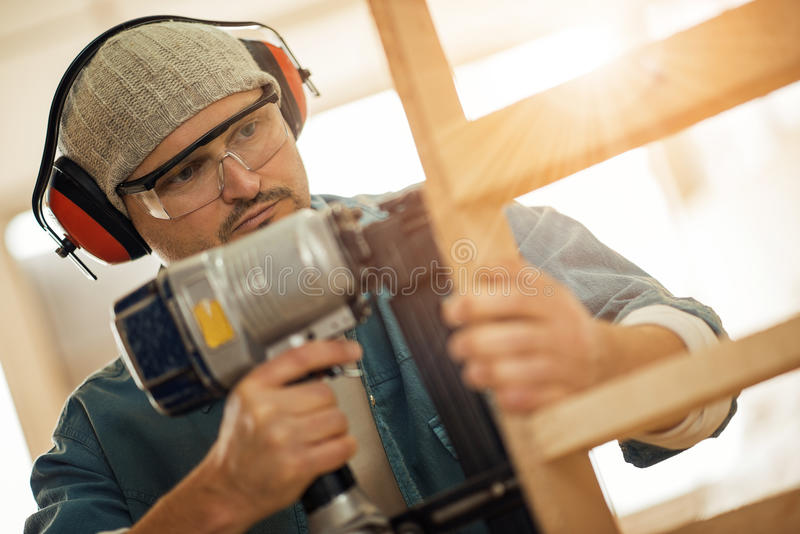 Close up of a young carpenter at work stock photography