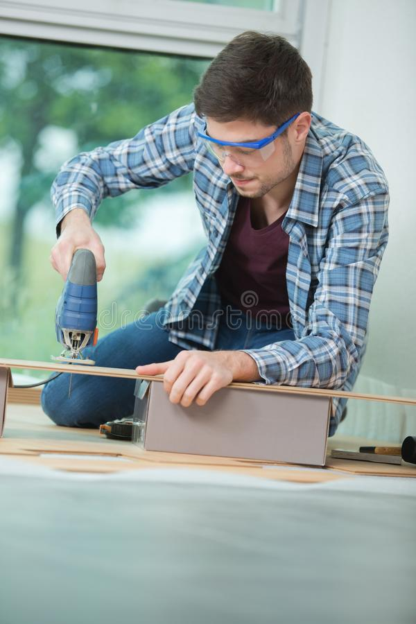 Close up young carpenter at work stock photography