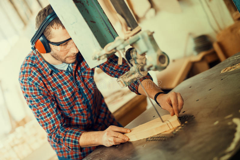 Close up of a young carpenter at work royalty free stock image
