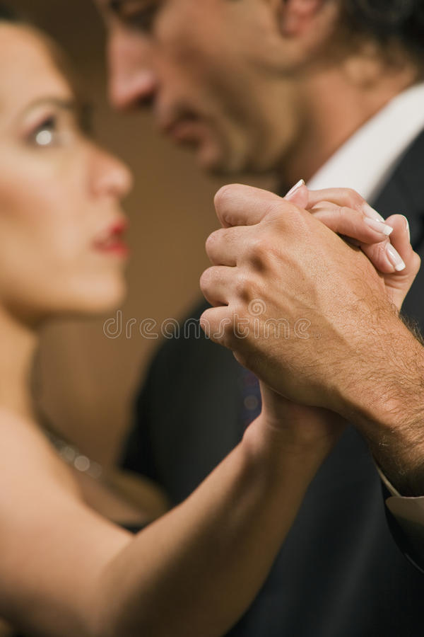 Close-up of a young couple dancing stock photos