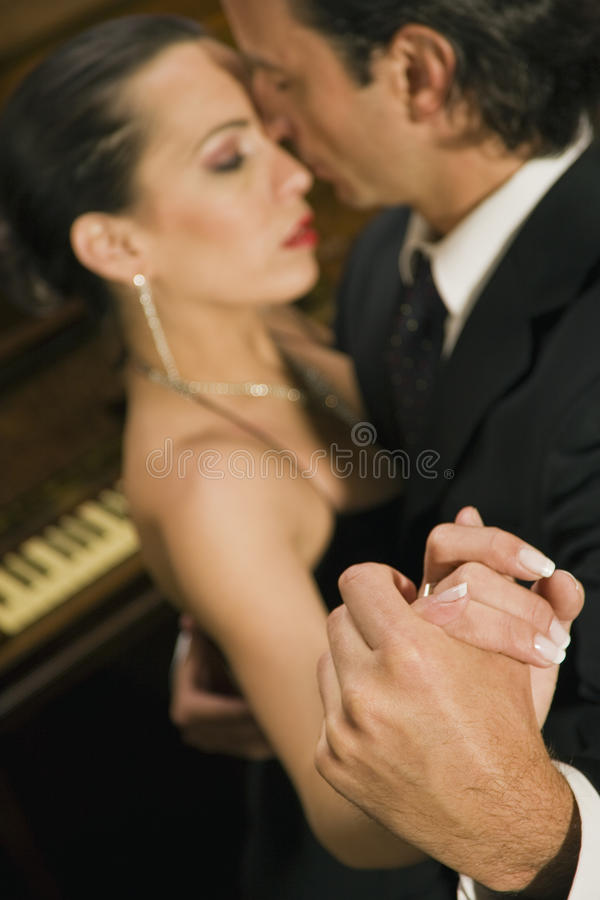 Close-up of a young couple dancing at a party stock photo