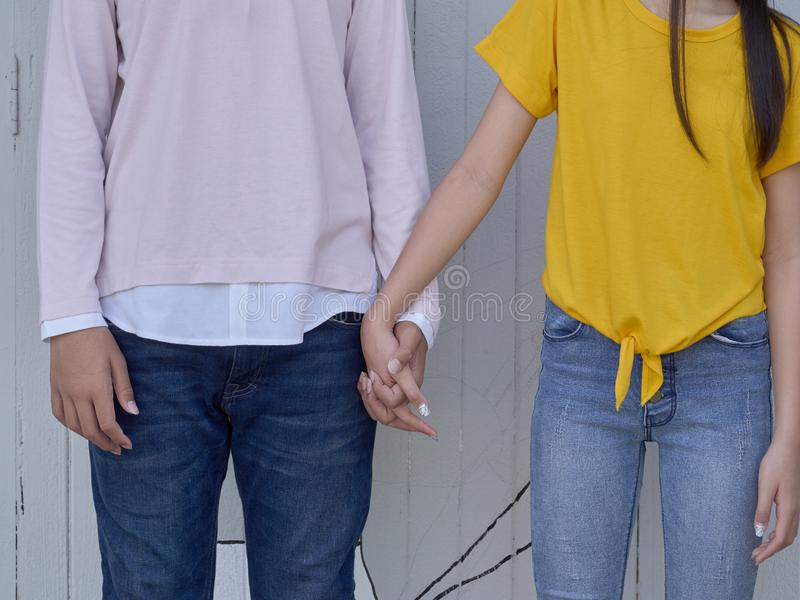 Close up of Young couple holding hands royalty free stock image