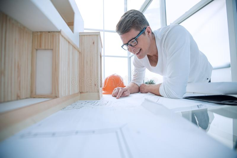 Close up. young designer reading a drawing of a new project. royalty free stock photography