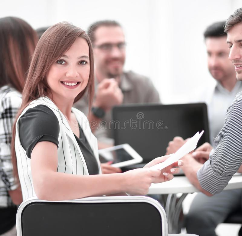 Close up.young employee with business team discussing financial documents stock images