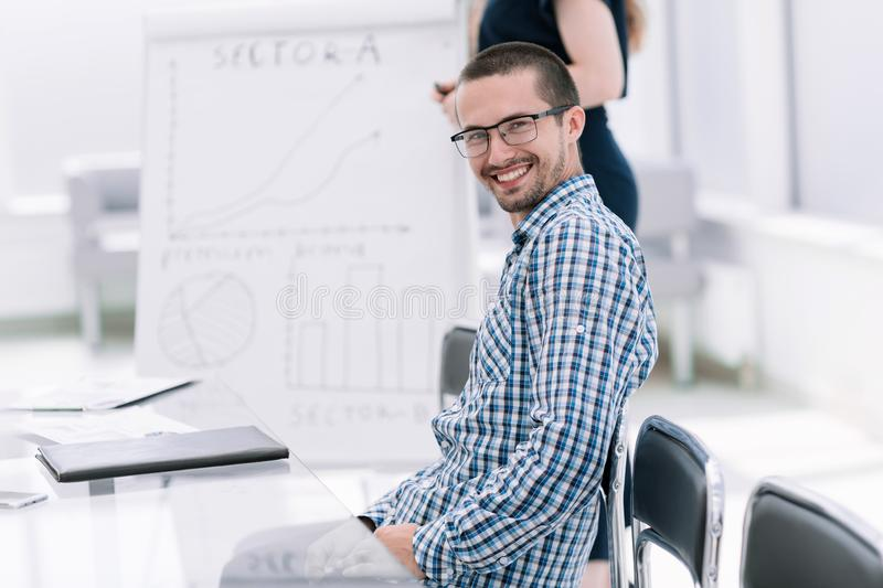 Close up.young employee sitting at his Desk royalty free stock image