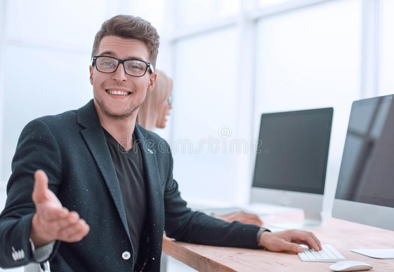 Young employee sitting at his Desk in the office stock photo