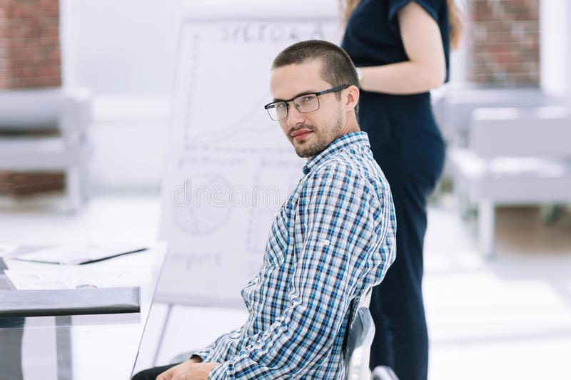 Close up.young employee sitting at his Desk. Photo with copy space stock photo